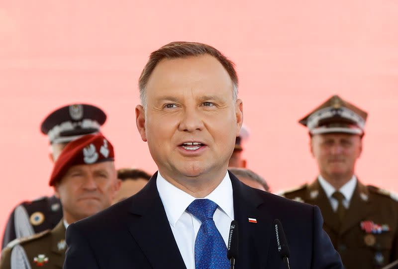 FILE PHOTO: Newly sworn-in Polish President Andrzej Duda attends the ceremony of accepting the sovereignty over the Armed Forces for the second five-year term, in Warsaw