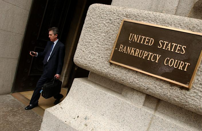 An unidentified man exits the United States Bankruptcy Court in Lower Manhattan in New York City. (Photo by Ramin Talaie/Corbis via Getty Images)