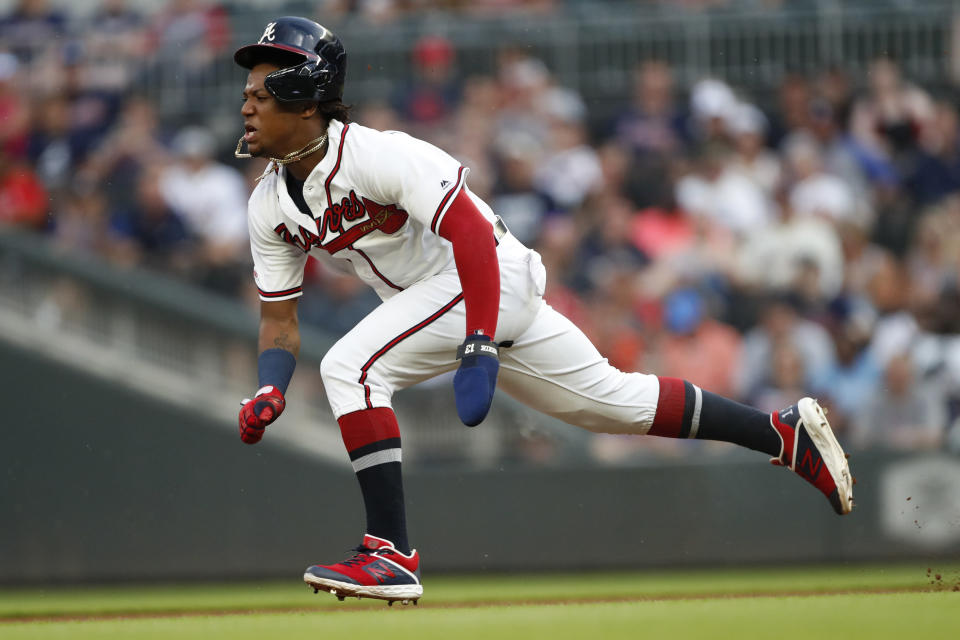 Atlanta Braves center fielder Ronald Acuna Jr. (13) steals second base in the first inning of a baseball game against the Washington Nationals Saturday, July 20, 2019, in Atlanta. (AP Photo/John Bazemore)
