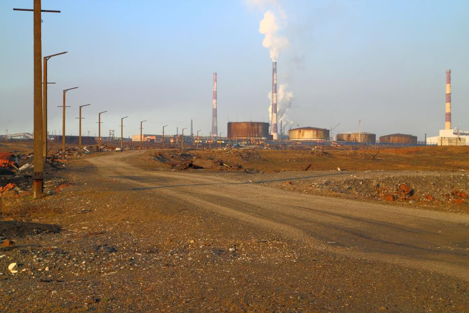 This handout photo provided by Vasiliy Ryabinin shows oil storage tanks outside Norilsk, 2,900 kilometers (1,800 miles) northeast of Moscow, Russia, Friday, May 29, 2020. Russian authorities have charged Vyacheslav Starostin, the director of an Arctic power plant that leaked 20,000 tons of diesel fuel into the ecologically fragile region on May 29, 2020, with violating environmental regulations. An investigation is ongoing into the alleged crime, that could bring five years in prison if Starostin is found guilty. (Vasiliy Ryabinin via AP)