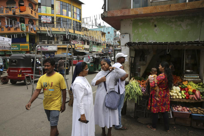"""Sri Lankan catholic nuns wait for transportation in Colombo, Sri Lanka, Monday, April 29, 2019. The Catholic Church in Sri Lanka says the government should crack down on Islamic extremists with more vigor """"as if on war footing"""" in the aftermath of the Easter bombings. (AP Photo/Manish Swarup)"""