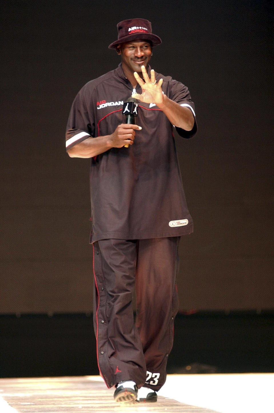 Michael Jordan waves to fans during an event to promote his brand-name sportswear, on May 22, 2004, in Taipei, Taiwan. (AP Photo/Jerome Favre)