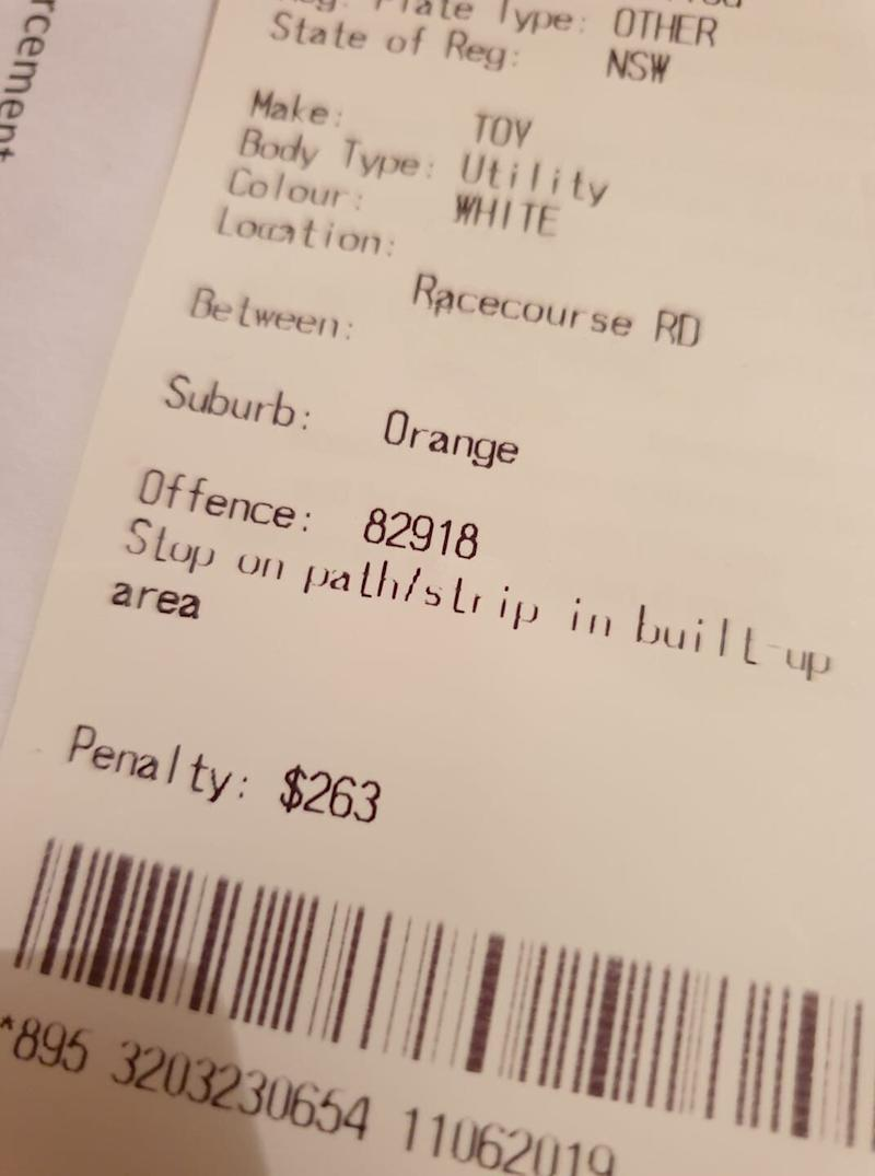 A picture of a $263 fine issued by Orange council to a woman parked on her front lawn. Source: Supplied