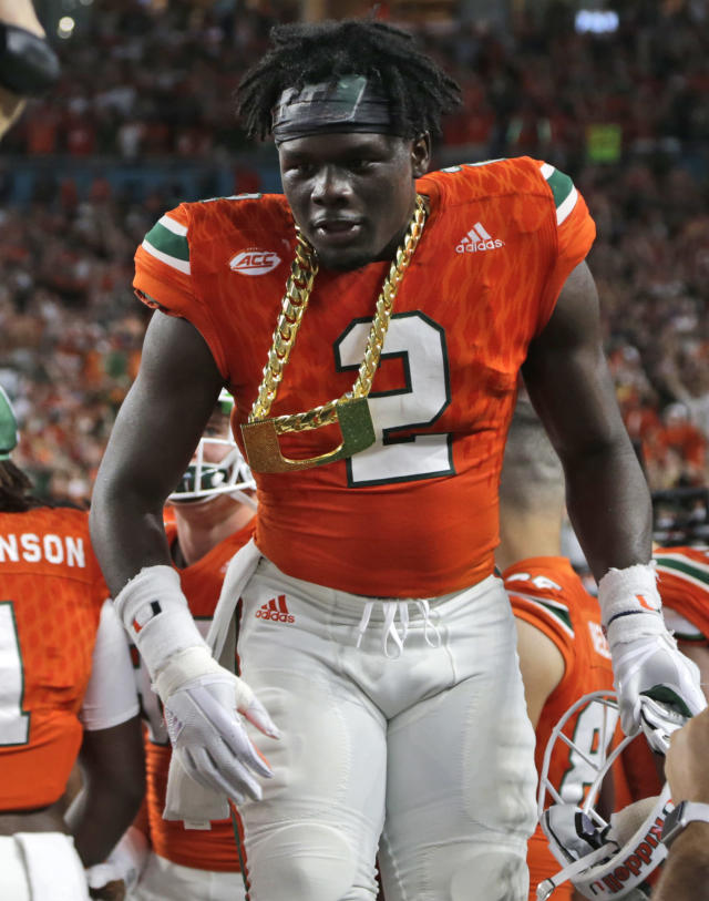 "Miami defensive back <a class=""link rapid-noclick-resp"" href=""/ncaaf/players/277111/"" data-ylk=""slk:Trajan Bandy"">Trajan Bandy</a> (2) wears the turnover chain after getting an interception during the first half of an NCAA college football game against Notre Dame, Saturday, Nov. 11, 2017, in Miami Gardens, Fla. (AP Photo/Lynne Sladky)"