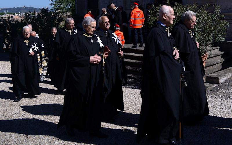 Former Grand Master Matthew Festing, second left, defied a Vatican order to stay away from yesterday's vote - Credit:  FILIPPO MONTEFORTE/AFP