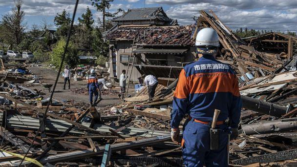 PHOTO: Search and rescue crews sort through the debris of a building destroyed by a tornado shortly before the arrival of Typhoon Hagibis, Oct. 13, 2019, in Chiba, Japan. (Carl Court/Getty Images)