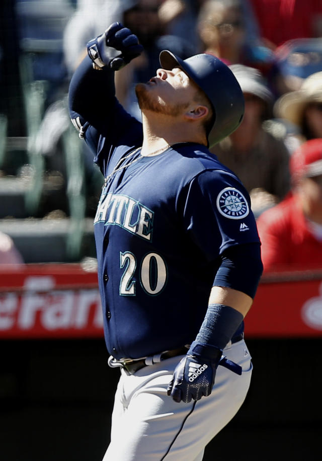 Seattle Mariners designated hitter Daniel Vogelbach reacts at the plate after hitting a two-RBI home run during the fourth inning of a baseball game against the Los Angeles Angels in Anaheim, Calif., Sunday, Sept. 16, 2018. (AP Photo/Alex Gallardo)