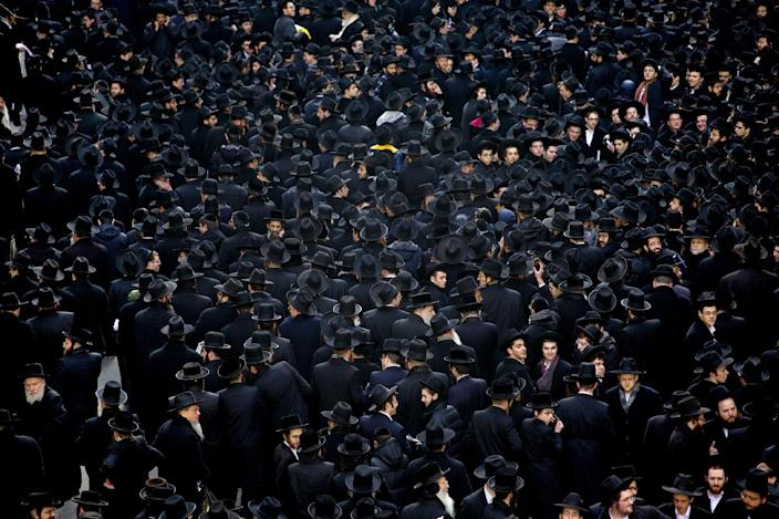 Thousands of Orthodox Jews begin to leave after gathering in New York, Sunday, March 9, 2014, on Water Street in lower Manhattan, to pray and protest against the Israeli government's proposal to pass a law that would draft strictly religious citizens into its army. (AP Photo/Craig Ruttle)