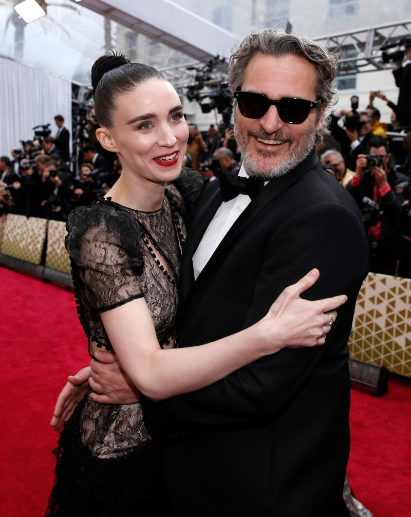 Joaquin Phoenix and Rooney Mara in Alexander McQueen embrace on the red carpet during the Oscars arrivals at the 92nd Academy Awards in Hollywood, Los Angeles, California, U.S., February 9, 2020. REUTERS/Mike Blake