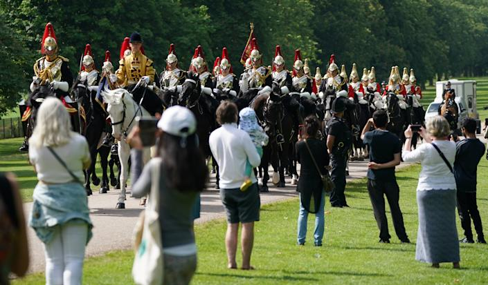 Members of the Household Cavalry make their way down the Long Walk towards Windsor Castle ahead of a ceremony to mark the official birthday of Queen Elizabeth II. Picture date: Saturday June 12, 2021.