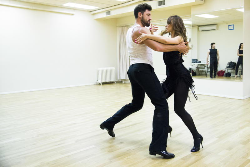 "In this June 28, 2013 photo, dancers Karina Smirnoff and Maksim Chmerkovskiy, left, rehearse for the upcoming Broadway show ""Forever Tango"" in New York. Smirnoff and Chmerkovskiy, best known for their work on ""Dancing with the Stars,"" will star in the revival of Luis Bravo's ""Forever Tango,"" which traces the dance's birth on the streets of 19th-century Buenos Aires to its more modern manifestations. (Photo by Charles Sykes/Invision/AP)"