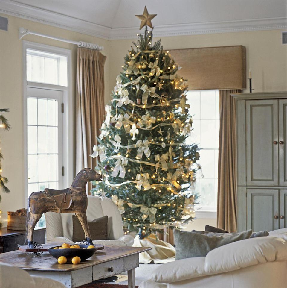 """<p>For a luxe look, wrap your Christmas tree with shimmery white organza ribbon, then cover the tree with big bows made of the same ribbon.</p><p><a class=""""link rapid-noclick-resp"""" href=""""https://www.amazon.com/Yards-Ivory-Shimmer-Organza-Ribbon/dp/B077SCZ46Y/ref=sr_1_22?tag=syn-yahoo-20&ascsubtag=%5Bartid%7C10050.g.28703522%5Bsrc%7Cyahoo-us"""" rel=""""nofollow noopener"""" target=""""_blank"""" data-ylk=""""slk:SHOP ORGANZA RIBBON"""">SHOP ORGANZA RIBBON</a></p>"""