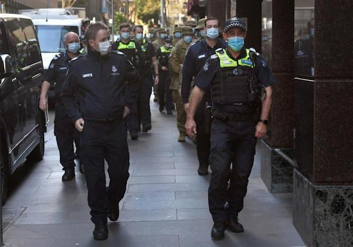 Experts have called for improved quarantine facilities and procedures to permit Australia's borders to slowly reopen