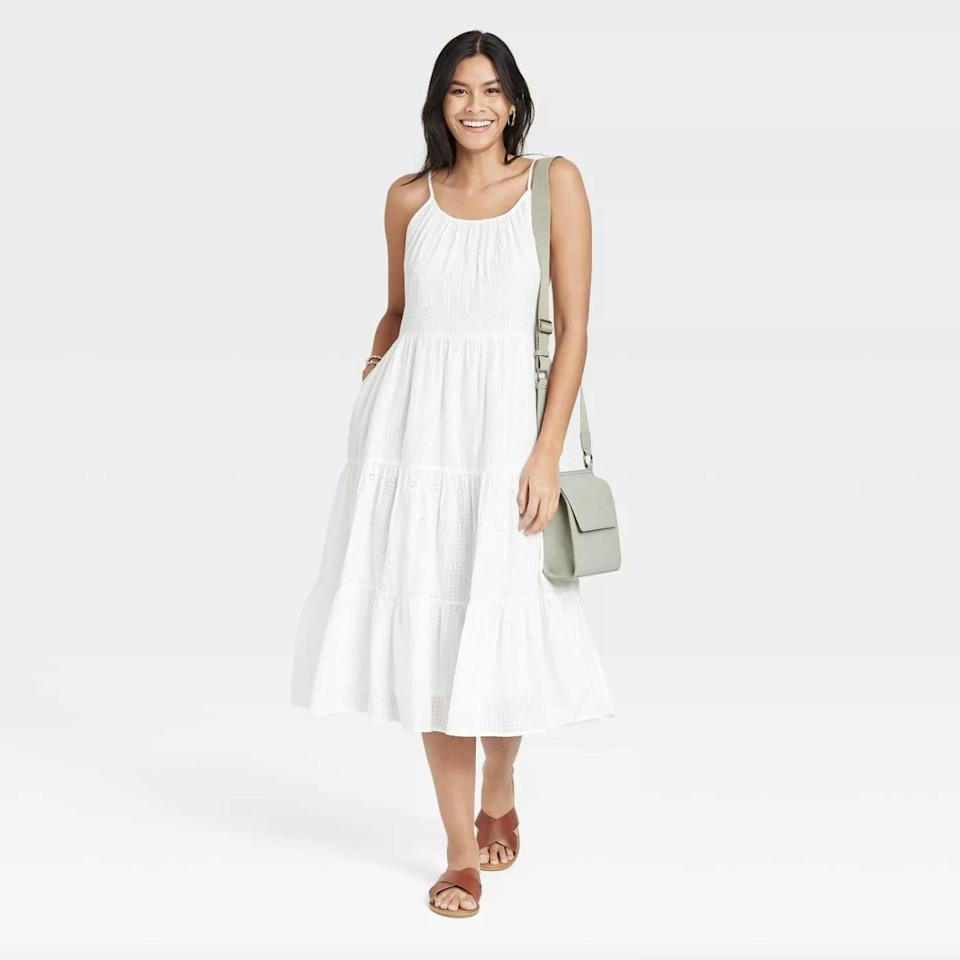<p>You almost can't picture summer moments without a classic white dress, like this <span>Universal Thread Sleeveless Tiered Dress</span> ($30).</p>