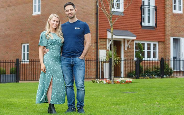 Jennifer and Luis outside their new property in Surrey
