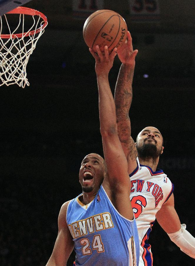 File-This Jan. 21, 2012 file photo shows New York Knicks' Tyson Chandler (6) blocking a shot by Denver Nuggets' Andre Miller (24) during the second half of an NBA basketball game in New York. A person with knowledge of the award says Chandler has been voted the NBA's Defensive Player of the Year. Yahoo Sports first reported Chandler's victory. The person told The Associated Press on condition of anonymity Tuesday May 1, 2012, because the official announcement was to come from the NBA. The award will be announced on Wednesday May 2. (AP Photo/Frank Franklin II, File)