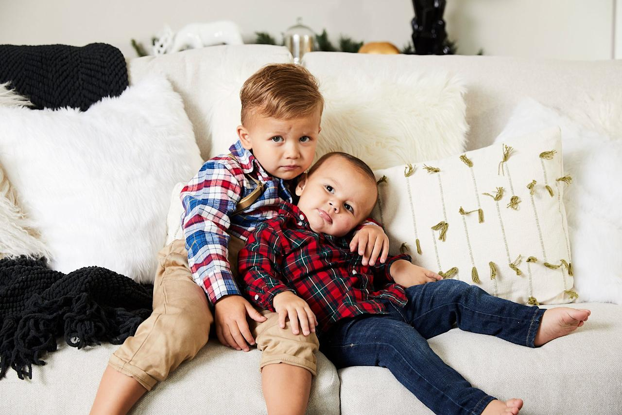 """Sean and Catherine <a href=""""https://people.com/parents/catherine-giudici-pregnant-sean-lowe-expecting-third-child-exclusive/"""">confirmed exclusively to PEOPLE</a> that they were pregnant with their third child in mid-June. The couple already have two sons: <a href=""""https://people.com/parents/sean-lowe-catherine-giudici-son-isaiah-hendrix-first-photos/"""">Isaiah Hendrix</a>, 1, and <a href=""""https://people.com/parents/sean-lowe-catherine-giudici-welcome-son-samuel-thomas/"""">Samuel Thomas</a>, 3.  Family friendliness was crucial to Catherine and Sean when designing their new collection. They aimed for both comfort and durability in their pieces, as well as items that would spark holiday joy.  """"Christmas has always been a favorite holiday of ours, but now with two kids and one on the way, it's huge at the Lowe house,"""" says the couple. """"We go all out for Christmas because we want to help create memories that our kids will hold onto for a lifetime.""""  <strong>Buy It!</strong> Mcmakin Lumbar Pillow, $37.92, <a href=""""http://www.anrdoezrs.net/links/8029122/type/dlg/sid/PEO,Sean&CatherineLoweDeckedtheHallsofTheirDallasHomewithFindsfromTheirNewCollection,hannahchubbmeredith,Unc,Gal,7432700,201911,I/https://www.wayfair.com/decor-pillows/pdp/gracie-oaks-mcmakin-lumbar-pillow-w001564822.html"""" target=""""_blank"""" rel=""""nofollow"""">wayfair.com</a>; Branchville Square Faux Fur Throw Pillow, $36.14, <a href=""""http://www.anrdoezrs.net/links/8029122/type/dlg/sid/PEO,Sean&CatherineLoweDeckedtheHallsofTheirDallasHomewithFindsfromTheirNewCollection,hannahchubbmeredith,Unc,Gal,7432700,201911,I/https://www.wayfair.com/decor-pillows/pdp/greyleigh-branchville-square-faux-fur-throw-pillow-gryl6314.html?piid=33396102"""" target=""""_blank"""" rel=""""nofollow"""">wayfair.com</a>"""