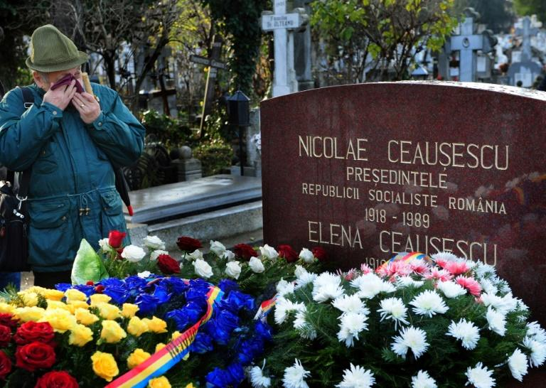 A man cries at the tomb of Nicolae Ceaucescu and his wife in Bucharest in 2010
