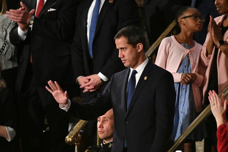 Venezuelan opposition leader Juan Guaido waves as he is acknowledged by US President Donald Trump during his the State of the Union address (AFP Photo/MANDEL NGAN)