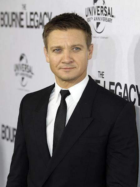 "FILE - This Aug. 7, 2012 file photo shows actor Jeremy Renner on the red carpet for the premier of ""The Bourne Legacy"" in Sydney, Australia. Renner, Julia Roberts, Matt Damon, Samuel L. Jackson and Emma Stone are among the stars participating in the third Stand Up to Cancer telethon, the organization announced Wednesday, Aug. 22. (AP Photo/Rob Griffith, file)"