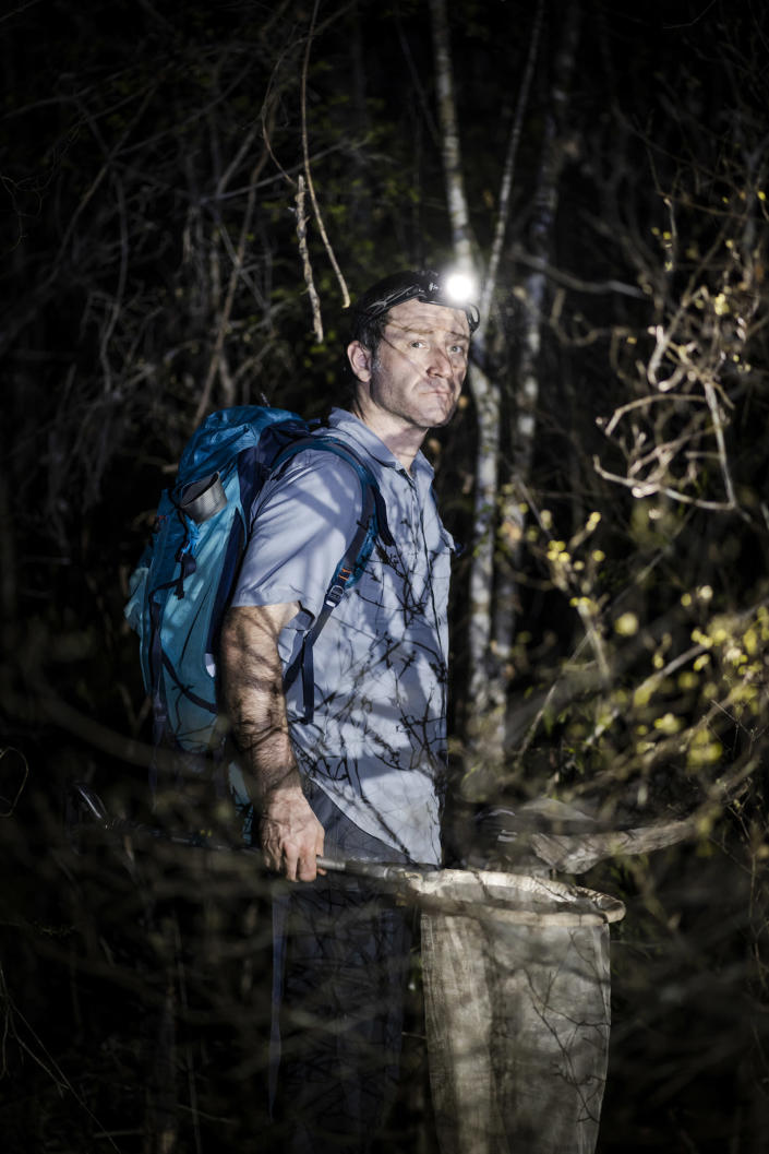 """Sylvain Hugel, a cricket specialist, collects specimens in the Menabe Antimena dry forest area in Madagascar on Nov. 22, 2019.<span class=""""copyright"""">Andy Isaacson</span>"""