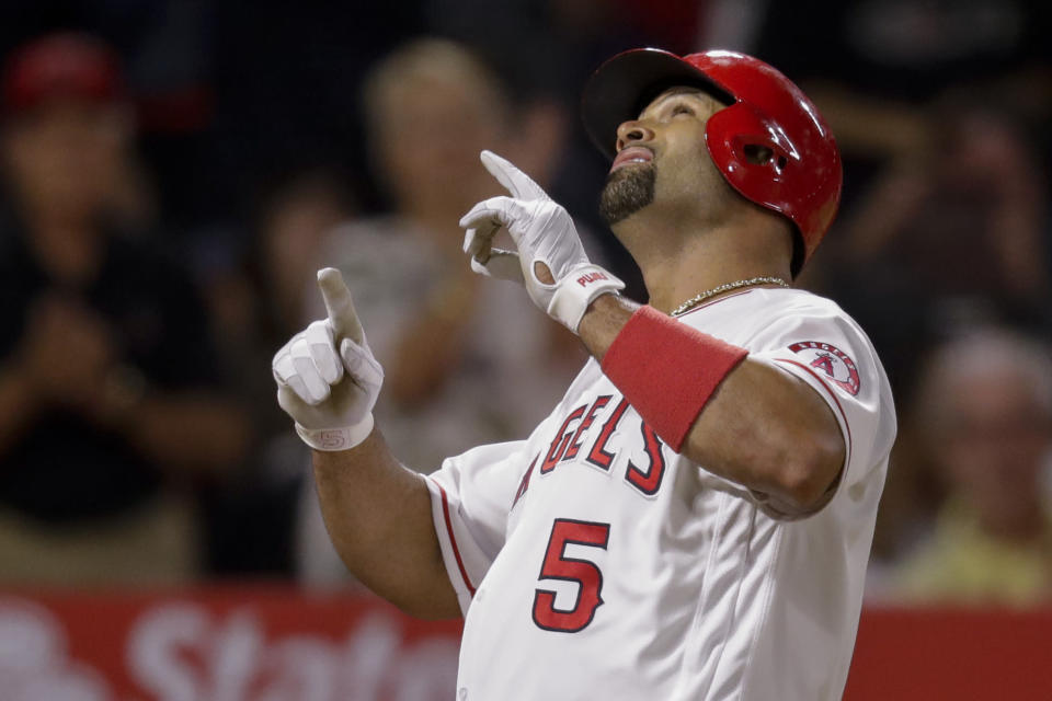 Los Angeles Angels' Albert Pujols celebrates after a home run against the Cleveland Indians during the second inning of a baseball game in Anaheim, Calif., Monday, Sept. 9, 2019. (AP Photo/Chris Carlson)