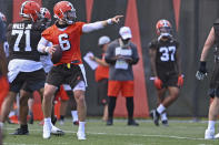 Cleveland Browns quarterback Baker Mayfield (6) points during an NFL football practice at the team training facility, Tuesday, June 15, 2021 in Berea, Ohio. (AP Photo/David Dermer)