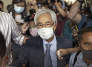 Pro-democracy activist Martin Lee walks out from a court after receiving a suspended sentence in Hong Kong Friday, April 16, 2021. A Hong Kong court on Friday sentenced five leading pro-democracy advocates, including media tycoon Jimmy Lai, to up to 18 months in prison for organizing a march during the 2019 anti-government protests that triggered an overwhelming crackdown from Beijing. A total of nine advocates were given jail terms, but four of them, including Lee, had their sentences suspended after their age and accomplishments were taken into consideration. (AP Photo/Vincent Yu)