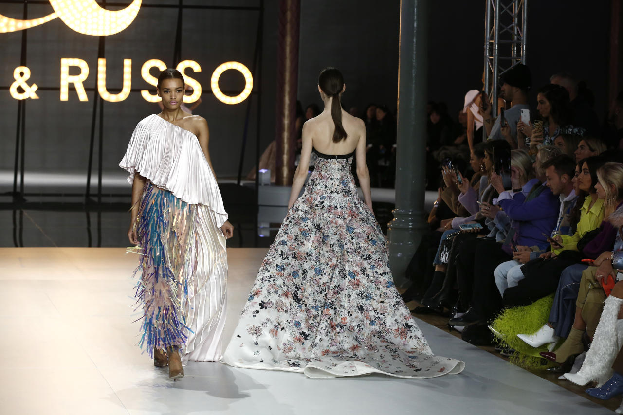 Models wear creations for the Ralph & Russo Spring/Summer 2019 Haute Couture fashion collection presented in Paris, Monday Jan. 21, 2019. (AP Photo/Michel Euler)