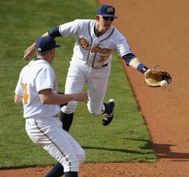 Montgomery Biscuits first baseman Cameron Seitzer (33) scoops the ball to pitcher Michael Colla for the out at first against the Tampa Bay Rays in a spring exhibition baseball game in Montgomery, Ala., Saturday, March 29, 2014. (AP Photo/Montgomery Advertiser, Mickey Welsh)