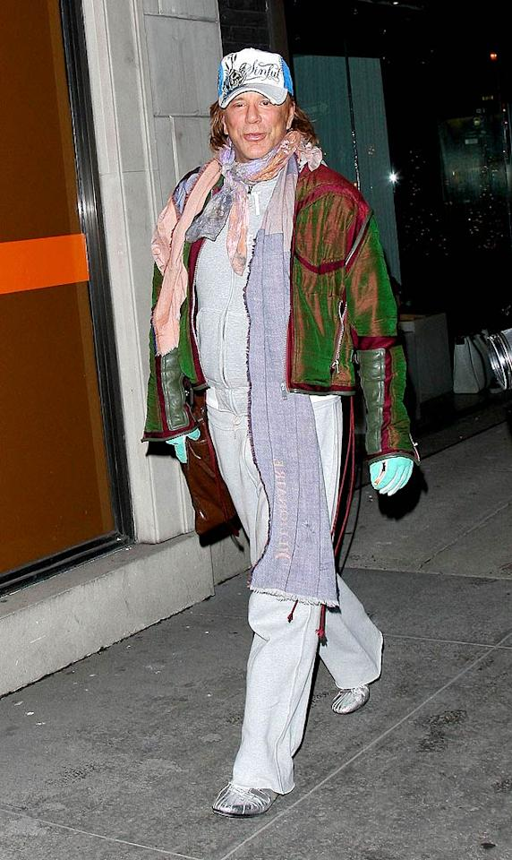 "What's the worst part of Mickey Rourke's ensemble? The outdated trucker hat? The dingy pink-and-purple scarf? The mint-green gloves? The multi-colored bomber jacket? The silver sneakers? Or, the fact that he was wearing sweats ... in public? <a href=""http://www.infdaily.com"" target=""new"">INFDaily.com</a> - March 4, 2009"