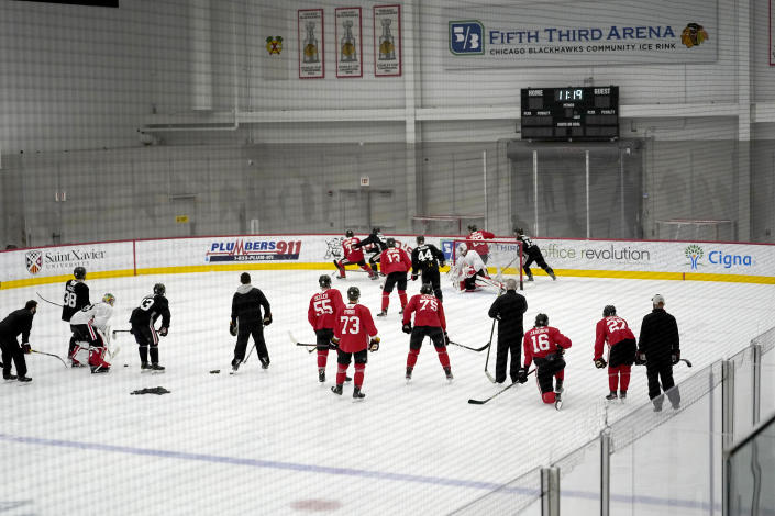 The Chicago Blackhawks begin their 2021 training camp during an NHL hockey practice Monday, Jan. 4, 2021, in Chicago. (AP Photo/Charles Rex Arbogast)