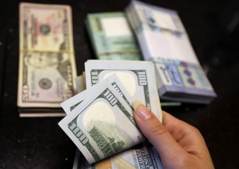 Dollar index dips to 11-week low as risk appetite improves