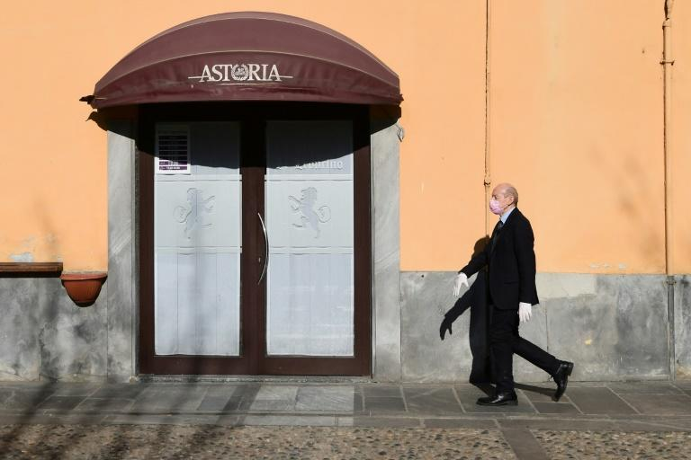 Italians have watched ever tighter restrictions slowly eat away at the very fabric of everyday life (AFP Photo/Miguel MEDINA)