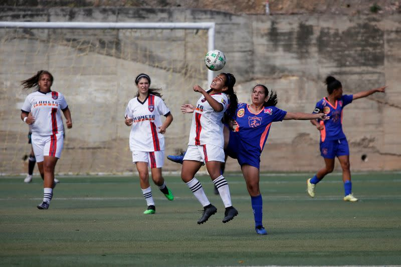 Deportivo Petare Futbol Club's player Mariannys Rodriguez heads the ball during a match in Caracas