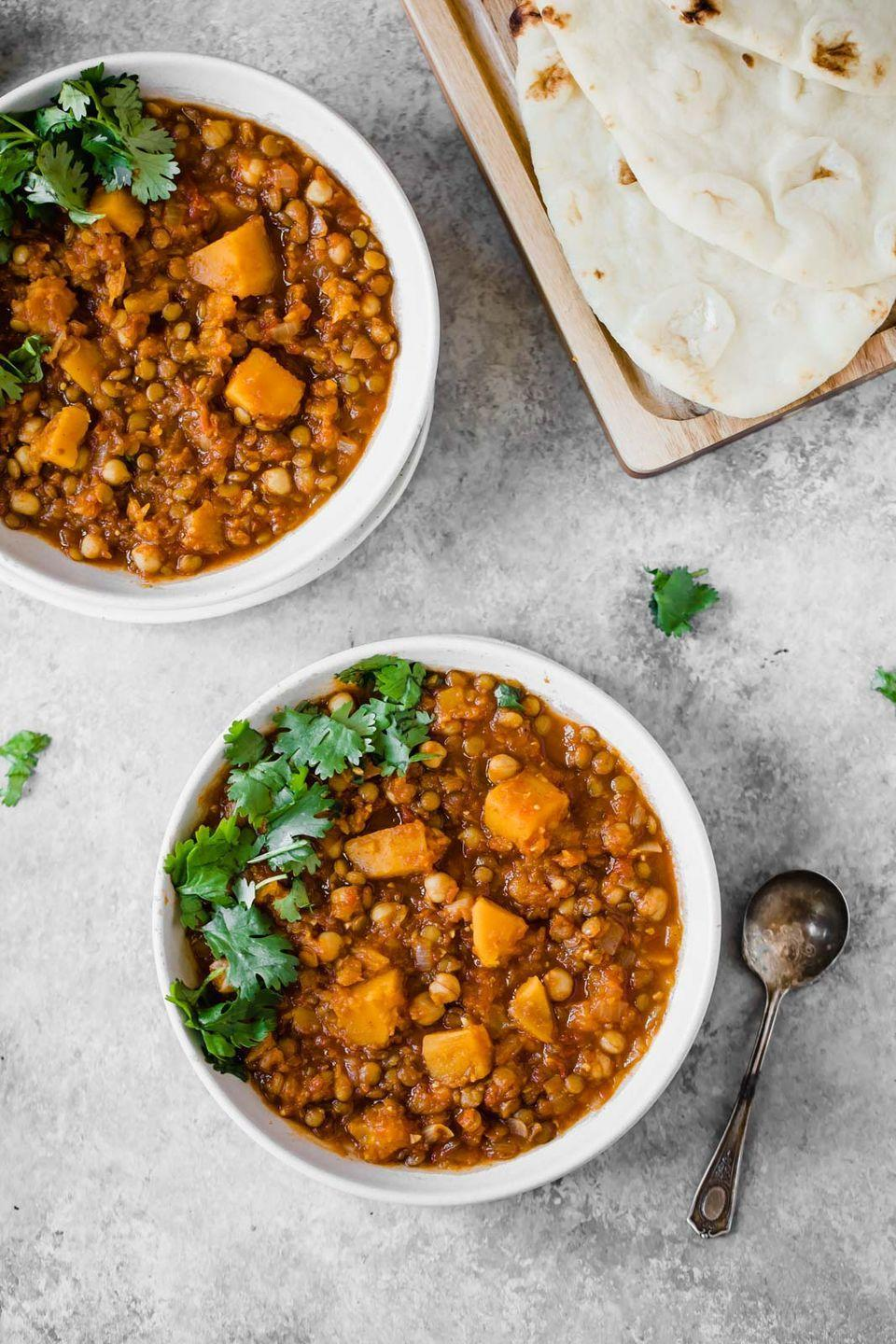 """<p>This hearty stew by<a href=""""https://www.ambitiouskitchen.com/butternut-squash-chickpea-lentil-moroccan-stew/"""" rel=""""nofollow noopener"""" target=""""_blank"""" data-ylk=""""slk:Ambitious Kitchen"""" class=""""link rapid-noclick-resp""""> Ambitious Kitchen</a> will not only warm you up on a chilly winter evening, but also it'll keep you full throughout the night, thanks to its high protein and fiber content. Fiber is particularly great for weight loss, as it slows digestion and helps limit mindless snacking. And the anti-inflammatory benefits from spices like turmeric, cumin, cayenne, and garlic will also speed the metabolism and promote weight loss.</p>"""