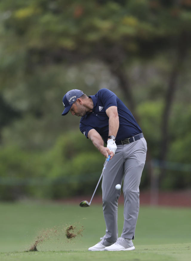 Sergio Garcia of Spain plays a shot on the 2nd hole during the first round of the DP World Tour Championship golf tournament in Dubai, United Arab Emirates, Thursday, Nov. 21, 2019. (AP Photo/Kamran Jebreili)