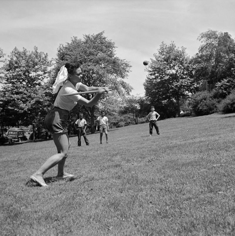 <p>Singer Eartha Kitt takes some time out of her busy schedule to play a friendly game of baseball in the park in 1952.</p>