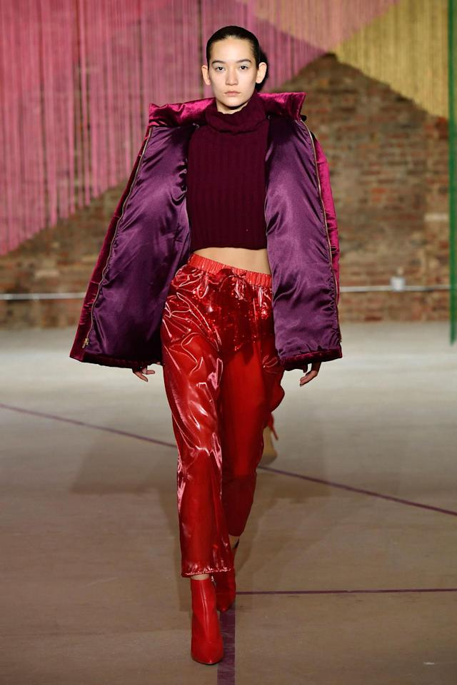 <p>Model wears a burgundy top, red trousers, and purple puffer jacket at the Milly Fall/Winter 2018 show. (Photo: Courtesy of Greg Kessler) </p>