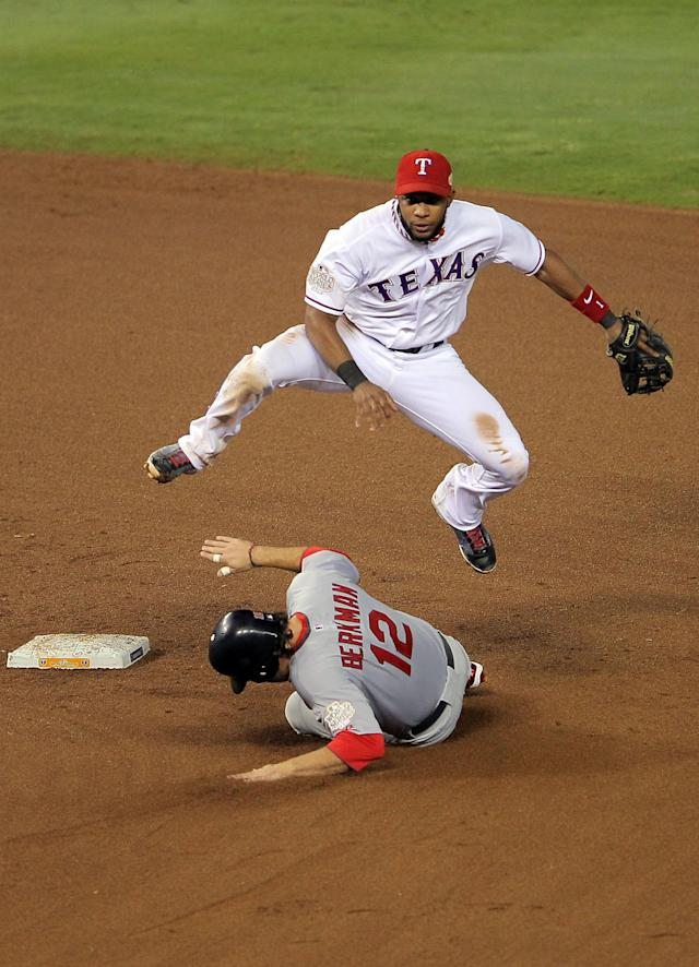 ARLINGTON, TX - OCTOBER 23: Elvis Andrus #1 of the Texas Rangers turns the double play as Lance Berkman #12 of the St. Louis Cardinals slides into second base in the fifth inning during Game Four of the MLB World Series at Rangers Ballpark in Arlington on October 23, 2011 in Arlington, Texas. (Photo by Doug Pensinger/Getty Images)