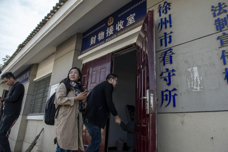 Xu and Yu's lawyers have tried and failed to get information from court officials (AFP Photo/NICOLAS ASFOURI)