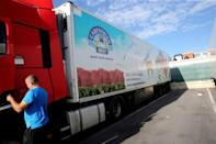 A truck at the meat processing plant Westvlees in Westrozebeke, Belgium after several employees tested positive for the coronavirus. One of Belgium's biggest meat processing plants has sent 225 staff home to quarantine