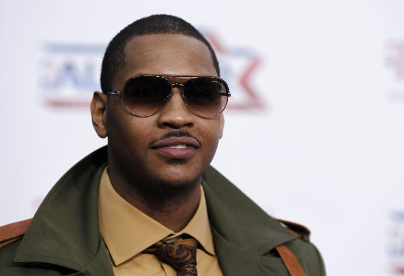 Carmelo Anthony, of the Denver Nuggets, arrives before the NBA basketball All-Star Game, Sunday, Feb. 20, 2011, in Los Angeles. (AP Photo/Matt Sayles)