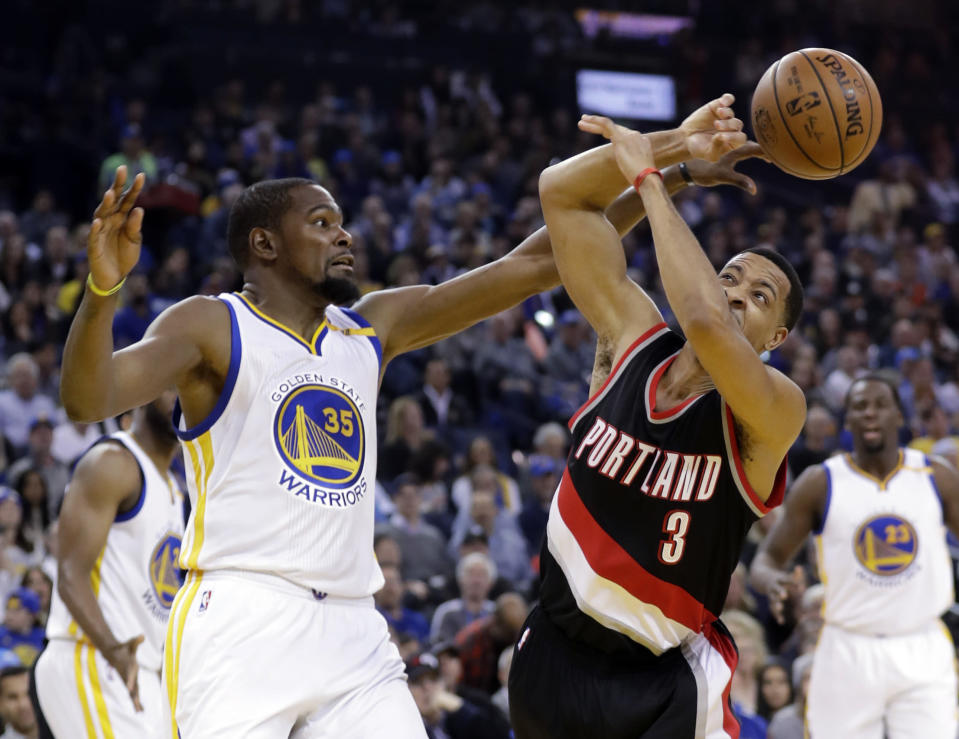 Kevin Durant and C.J. McCollum traded shots on Twitter after a tense podcast conversation. (AP)