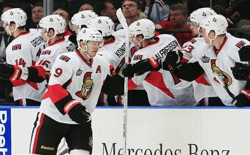 Ottawa Senators' Jason Spezza celebrates with teammates after scoring a goal during the second period of an NHL hockey game against the New York Rangers, Thursday, Jan. 12, 2012, in New York. (AP Photo/Frank Franklin II)