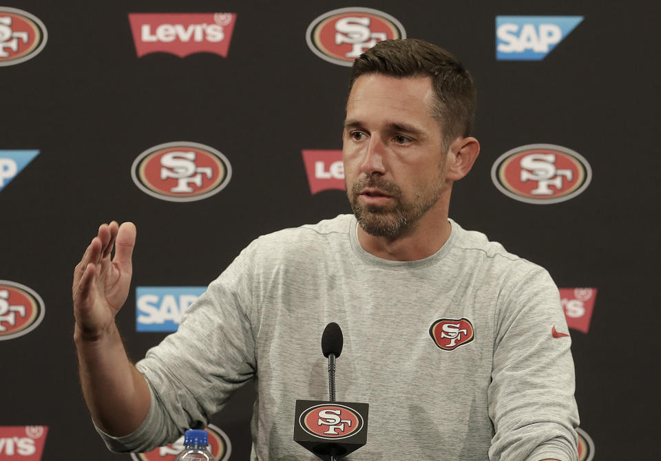San Francisco 49ers head coach Kyle Shanahan speaks to reporters before an NFL football practice at the team's headquarters in Santa Clara, Calif., Wednesday, June 13, 2018. Year one under coach Kyle Shanahan was a bit of a whirlwind for the 49ers with new systems to install and a midseason quarterback change to Jimmy Garoppolo. It's far different this year as the Niners wrap up the offseason program. (AP Photo/Jeff Chiu)
