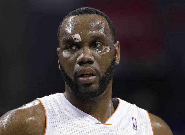 Charlotte Bobcats' Al Jefferson walks to the free throw line with a bandage over his right eye after being injured during the first half of an NBA basketball game against the Washington Wizards in Charlotte, N.C., Monday, March 31, 2014. (AP Photo/Chuck Burton)