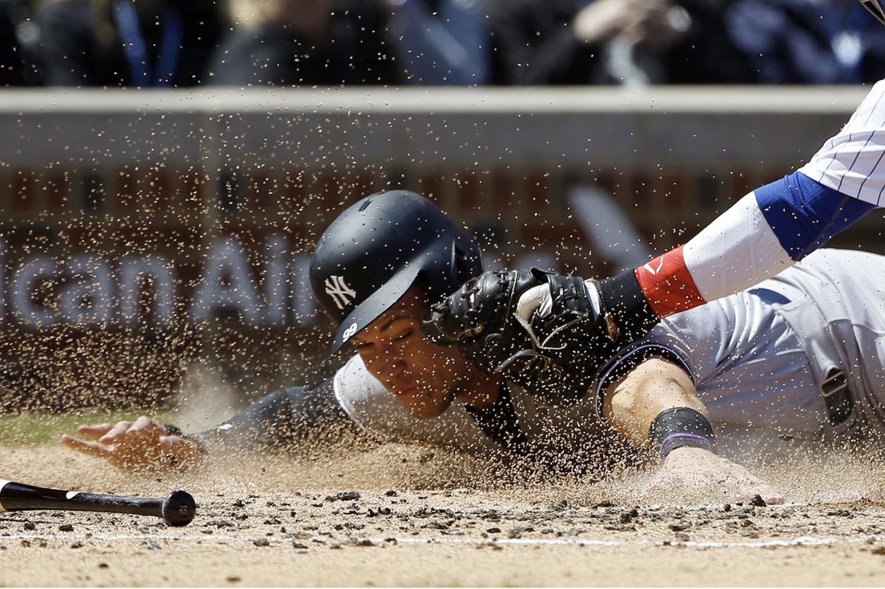 <p>New York Yankees' Aaron Judge is tagged out at home plate by Chicago Cubs catcher Willson Contreras during the second inning of an interleague baseball game May 5, 2017 in Chicago. (Photo: Nam Y. Huh/AP) </p>