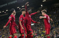 Liverpool's Divock Origi, center, celebrates scoring their side's second goal of the game with team-mates during the English League Cup third round soccer match at Carrow Road, Norwich, England, Tuesday Sept. 21, 2021. (Joe Giddens/PA via AP)