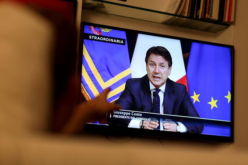 ROME, ITALY - MARCH 21: A man watches tv as Italian Prime Minister Giuseppe Conte announces the shut down of all non-essential production activities during a special Facebook and TV live broadcast due to Coronavirus emergency on March 21, 2020 in Rome, Italy. The Italian government continues to enforce the nationwide lockdown measures to control the spread of COVID-19. (Photo by Franco Origlia/Getty Images) (Photo: Franco Origlia via Getty Images)